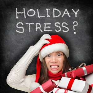 Christmas holiday stress. Stressed woman shopping for gifts hold